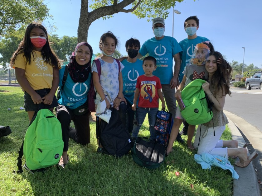 Volunteers and recipients of the backpack giveaway at Farr Elementary School in Escondido, sponsored by ICNA Relief USA.