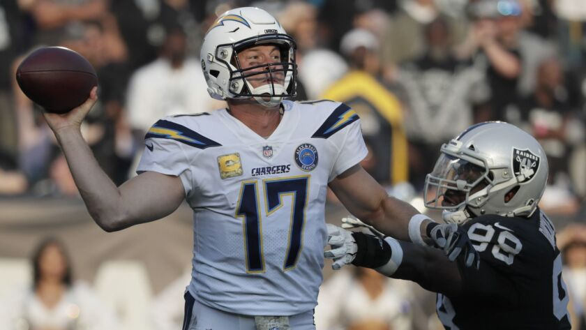 OAKLAND, CA, SUNDAY, NOVEMBER 11, 2018 - Chargers quarterback Philip Rivers launches a pass as he is