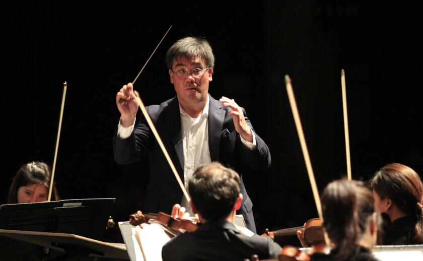 New York Philharmonic music director Alan Gilbert conducting the Academy Festival Orchestra in Santa Barbara in July.