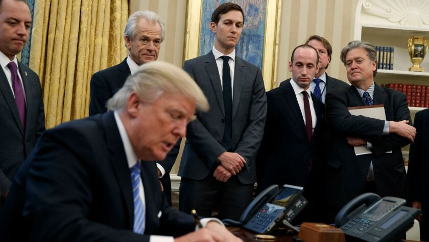 Among President Trump's top advisors are Stephen K. Bannon, far right, and Stephen Miller, to Bannon's right.
