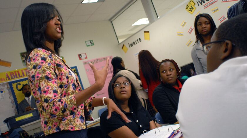 History teacher Shawonna Coleman discusses segregation with sophomores at Benjamin E. Mays High School in Atlanta, Ga. on Aug. 27, 2013.