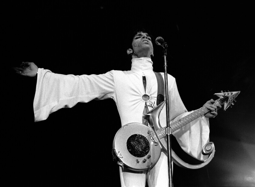 For most of his career, Prince, a master of soul, funk, pop and rock, mixed feminine and masculine style for a symbol that he used for his guitars and on album covers that briefly became his name after a feud with Warner Bros. Records. (Paul Bergen/Redferns)