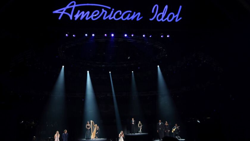 """The """"American Idol"""" series finale in 2016 with appearances by, from left, Katharine McPhee, Casey James, Carly Smithson, Jessica Sanchez, Clay Aiken, Ruben Studdard and Amber Holcomb."""