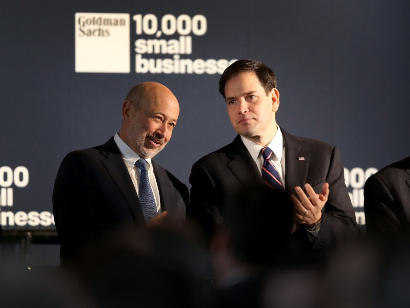 Does Goldman Sachs Chairman and CEO Lloyd Blankfein, left, have your financial interests at heart? Above, Blankfein, left, at an appearance this month with Sen. Marco Rubio (R-Fla.).
