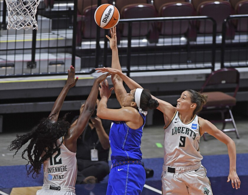 Connecticut Sun forward Brionna Jones is fouled on her shot as New York Liberty forward Michaela Onyenwere (12) and Rebecca Allen (9) defend during a WNBA basketball game Saturday, June 5, 2021, in Uncasville, Conn. (Sean D. Elliot/The Day via AP)