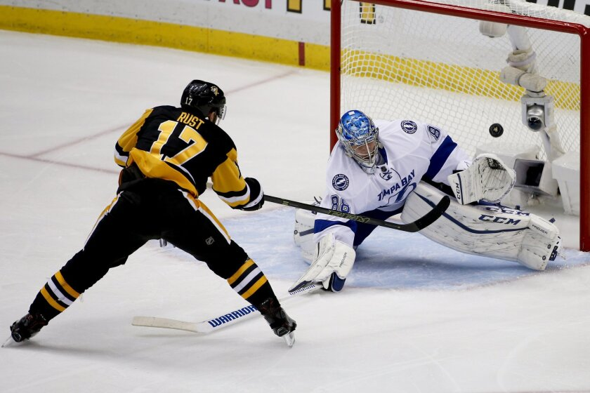 Pittsburgh Penguins' Bryan Rust (17) misses a shot on Tampa Bay Lightning goalie Andrei Vasilevskiy during the third period of Game 7 of the NHL hockey Stanley Cup Eastern Conference finals, Thursday, May 26, 2016, in Pittsburgh. (AP Photo/Gene J. Puskar)