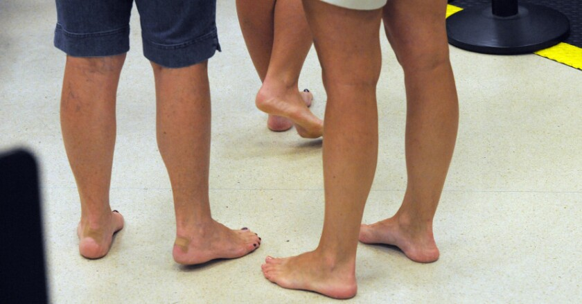 Barefoot passengers wait to retrieve their shoes while going through the TSA checkpoint at Hartsfield–Jackson Atlanta International Airport in 2011.