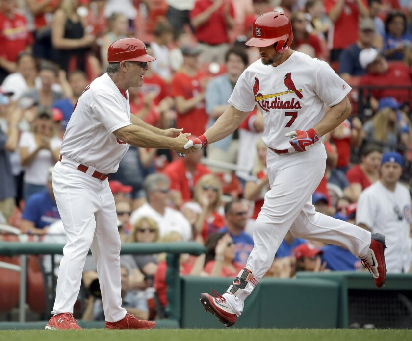St. Louis Cardinals' Matt Holliday, right, is congratulated by third base coach Chris Maloney after hitting a three-run home run during the sixth inning of a baseball game Wednesday, May 25, 2016, in St. Louis. (AP Photo/Jeff Roberson)