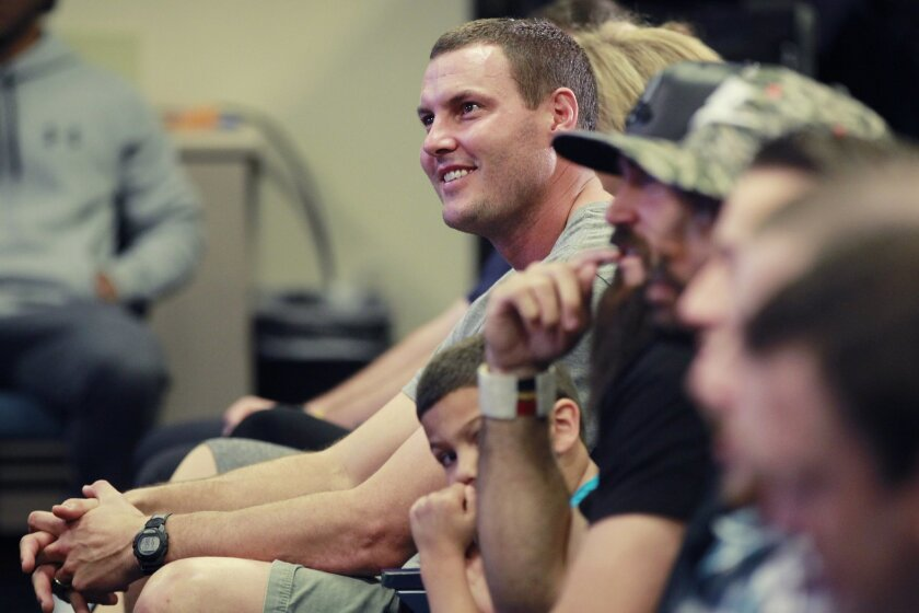 Chargers quarterback Philip Rivers looks on as center Nick Hardwick announced his retirement after 11 seasons playing for the team.