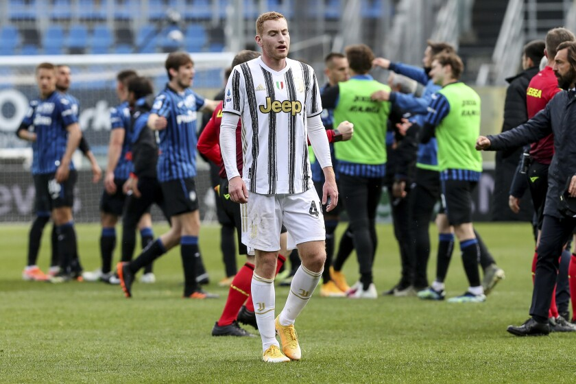 Juventus' Dejan Kulusevski leaves at the end of a Serie a soccer match between Atalanta and Juventus, in Bergamo stadium, Sunday, May 18, 2021. (Stefano Nicoli/LaPresse via AP)