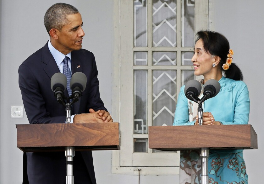 President Obama and Myanmar opposition leader Aung San Suu Kyi speak to reporters after meeting at Suu Kyi's home in Yangon on Nov. 14.