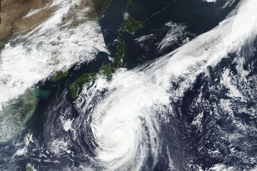 This Oct. 10, 2019, satellite photo taken by NASA-NOAA's Suomi NPP satellite shows typhoon Hagibis approaching Japan, center left. Japan's weather agency is warning a powerful typhoon may bring torrential rains to central Japan over the weekend. (NASA Worldview, Earth Observing System Data and Information System (EOSDIS) via AP)