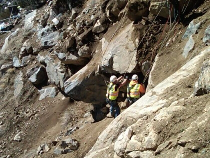 This photo provided by the Colorado Department of Transportation Tuesday April 5, 2011, shows a 25-mile stretch of Interstate I-70, Colorado's vital east-west highway, closed for boulder removal above the one-time silver mining town of Georgetown. Large boulders, as well as some smaller rocks, have been brought down so far Tuesday above the highway interstate. Crews plan to remove a total of 40 boulders at risk of rolling onto the highway. The state transportation department says none of the rocks have rolled onto the highway or to nearby houses on the other side of the road. Residents of five homes were asked to evacuate during the work. (AP Photo/Colorado Department of Transportation)