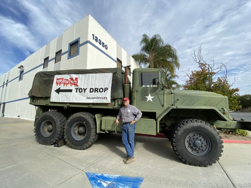 Delkin Devices CEO Martin Wood with the 5-ton Marine vehicle in front of the business.