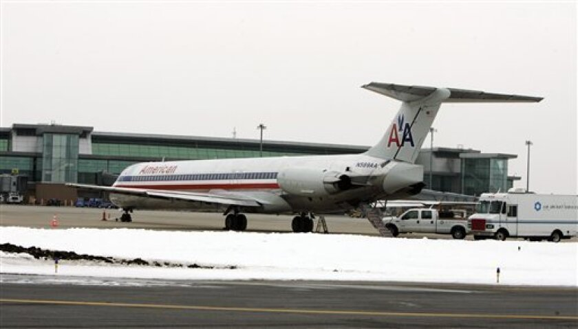 An American Airlines plane that was diverted to Oklahoma City after it lost cabin pressure sits on the tarmac at the airport in Oklahoma City, Wednesday, Feb. 3, 2010. The MD-80 aircraft is now out of service and could be sent from Oklahoma City to the airline's maintenance shop in Tulsa if the problem appears serious, said American spokesman Tim Smith in Fort Worth. (AP Photo/Sue Ogrocki)