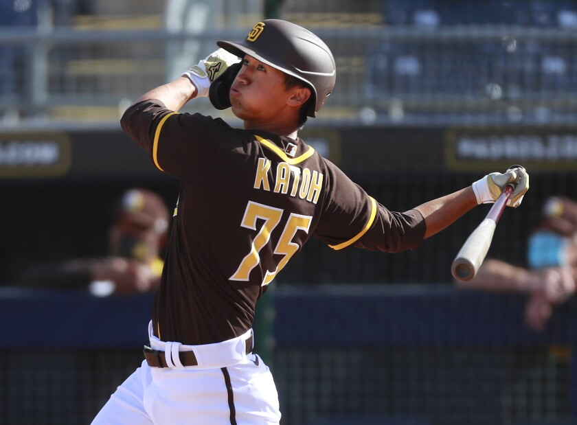 Padres infielder Gosuke Katoh hits a home run against the Milwaukee Brewers in Wednesday's spring training game.