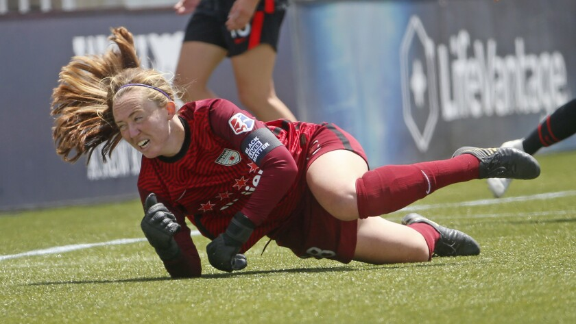 Chicago Red Stars goalkeeper Cassie Miller dives for the ball during the second half of an NWSL Challenge Cup soccer match against the Portland Thorns FC at Zions Bank Stadium on Wednesday, July 1, 2020, IN Herriman, Utah. (AP Photo/Rick Bowmer)