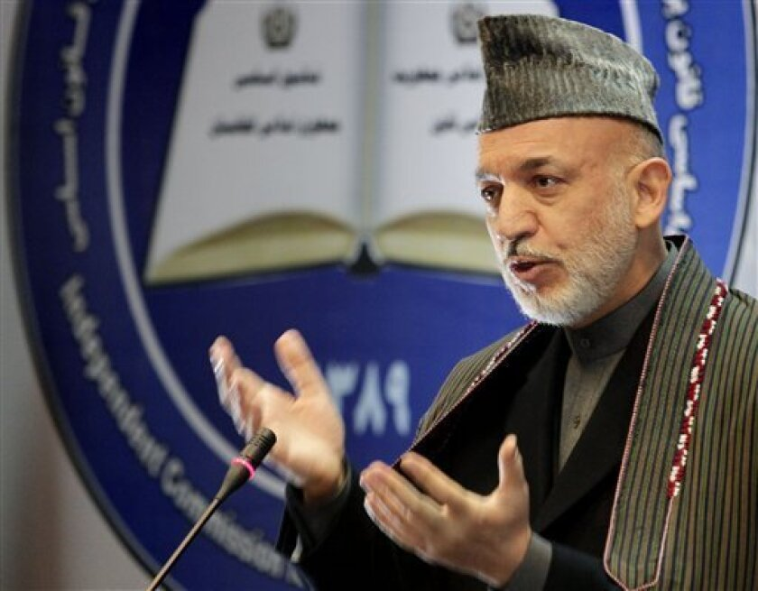 Afghan President Hamid Karzai speaks during a gathering marking the seventh adoption year of Afghanistan's Constitution in Kabul, Afghanistan on Tuesday, Jan. 4, 2011. (AP Photo/Musadeq Sadeq)