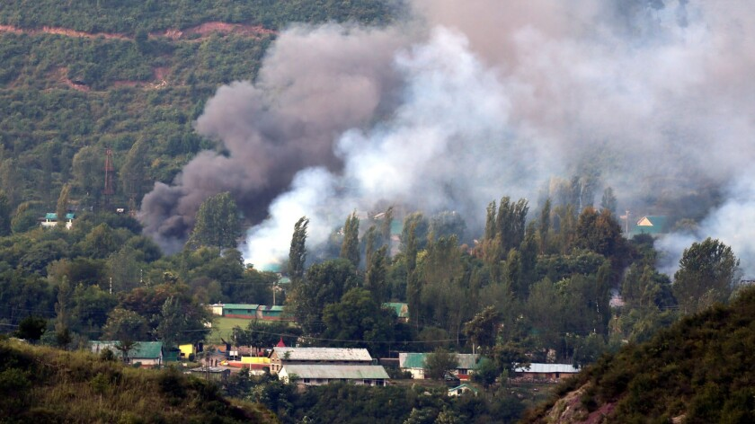 Smoke billows from an Indian army base that was attacked by suspected militants in Uri, in Indian Kashmir, on Sunday.