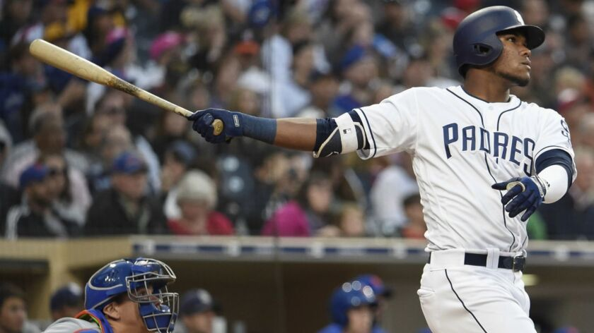 The Padres' Franchy Cordero hits a three-run home run during the fourth inning of a baseball game against the New York Mets at Petco Park on April 28, 2018 in San Diego, California.