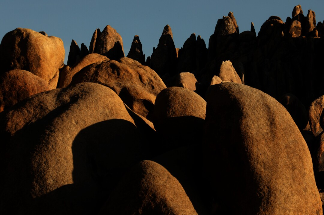 Rock formations bathed in golden light in the Alabama Hills National Scenic Area