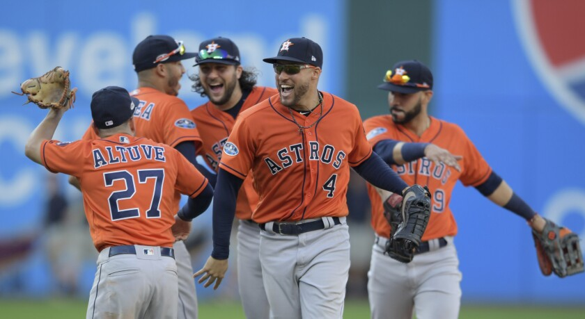 Houston Astros' George Springer (4) and teammates celebrate after defeating the Cleveland Indians in