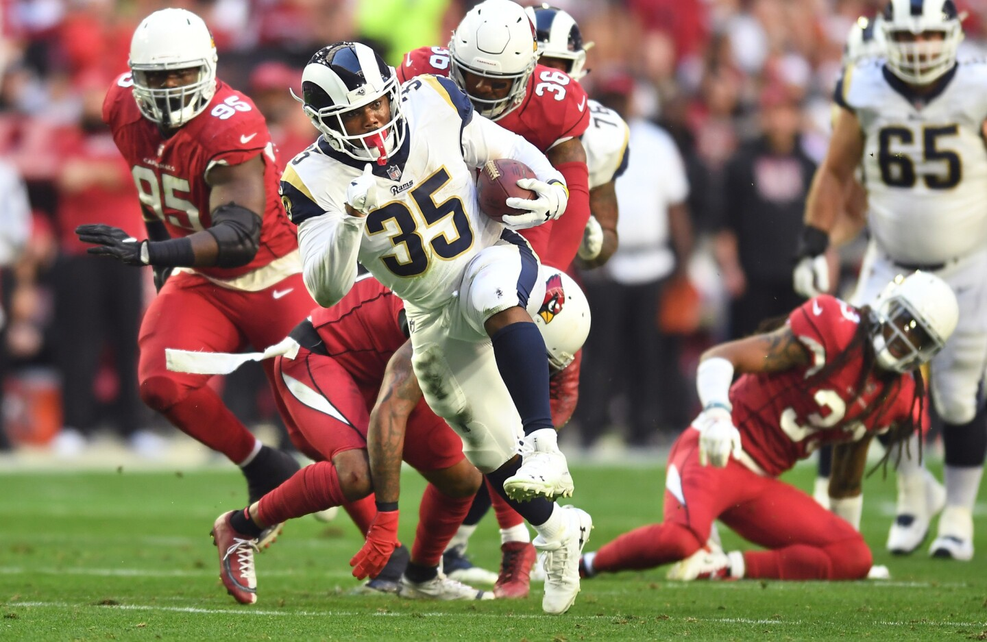 Rams running back C.J. Anderson picks up big yards against the Arizona Cardinals in the second quarter at State Farm Stadium on Sunday in Glendale, Ariz.