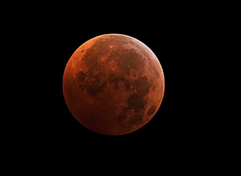 The moon during the peak of a total eclipse on Dec. 21, 2010. It will take on this color again in a series of total eclipses beginning April 14.
