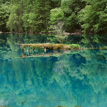 """Blue and green lakes as well as waterfalls dot Jiuzhai Valley National Park in southwestern China north of Chengdu. The area, called Jiuzhaigou (""""nine village valley""""), includes Lake Wuhuahai (pictured)."""