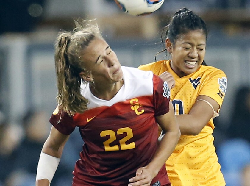 USC's Ashleigh Plumptre heads the ball in front of West Virginia's Carla Portillo during the 2016 NCAA Women's College Cup soccer final.