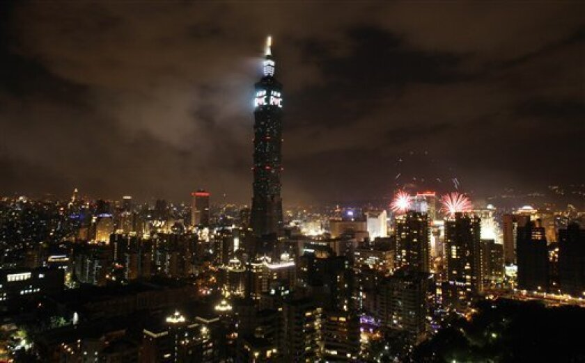 """In this photo taken Saturday, Jan. 1, 2011, Taiwan's tallest skyscraper Taipei101 displays a """"100 R.O.C."""" sign marking the 100 years of the Republic of China, known to the world as Taiwan, as the country ushers in the new year in Taipei, Taiwan. Taiwan is celebrating the centennial of its republic's birth during a revolution in China _ but a lack of interest by its own citizens shows the self-ruled island's evolving sense of identity and its changing relations with the Communist mainland. (AP Photo/Wally Santana)"""
