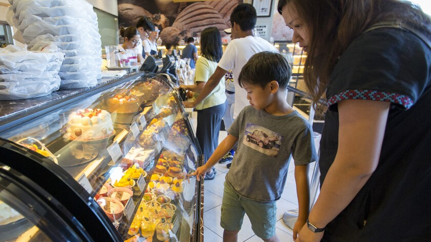 Julian Lai, 8, and his mom Fiona Kwei look at the pastrys at 85°C Bakery Cafe at Diamond Jamboree o