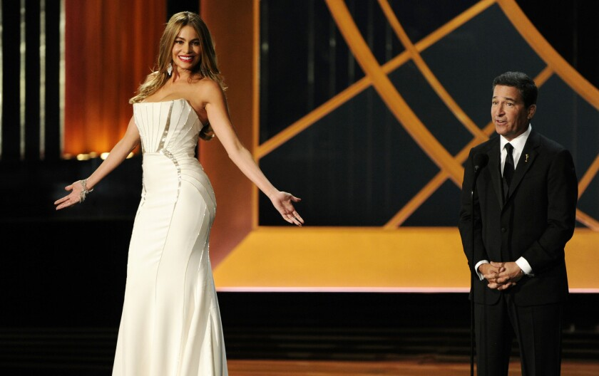 Sofia Vergara and Television Academy CEO Bruce Rosenblum on stage at the 66th Primetime Emmy Awards on Monday.