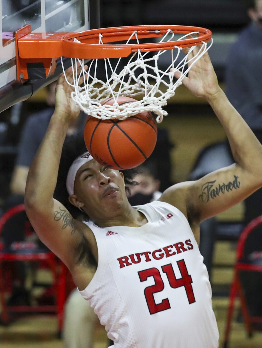 Rutgers guard Ron Harper Jr. dunks during the second half of the team's NCAA college basketball game against Minnesota on Thursday, Feb. 4, 2021, in Piscataway, N.J. (Andrew Mills/NJ Advance Media via AP)