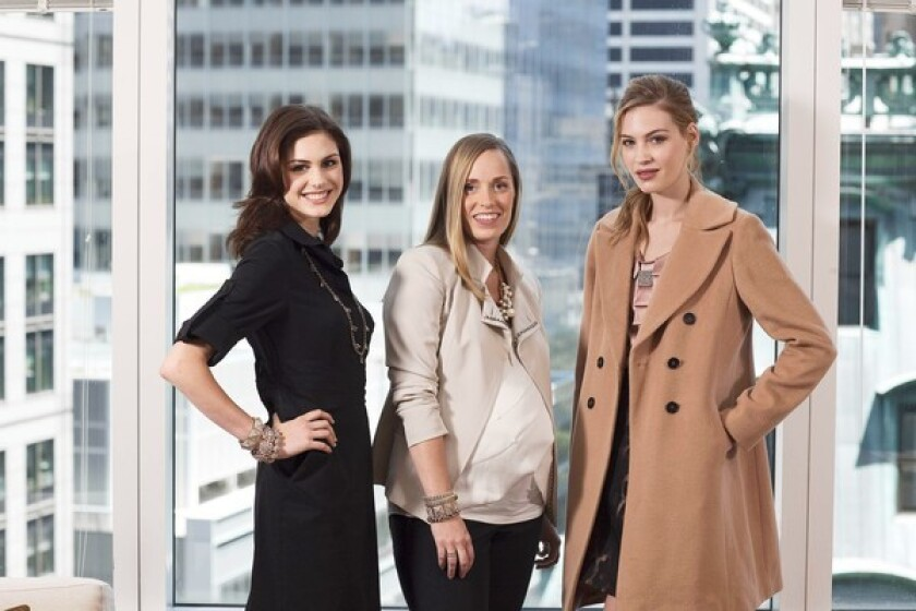 Ann Taylor creative director and mom-to-be Lisa Axelson, center, with models in clothes from the brand's collection.