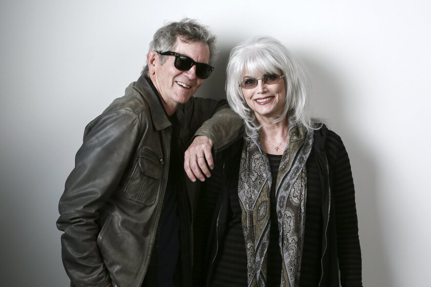 """In this April 30, 2015 photo, musicians Rodney Crowell, left, and Emmylou Harris pose for a portrait to promote their album """"The Traveling Kind"""" in New York. (Photo by Amy Sussman/Invision/AP)"""