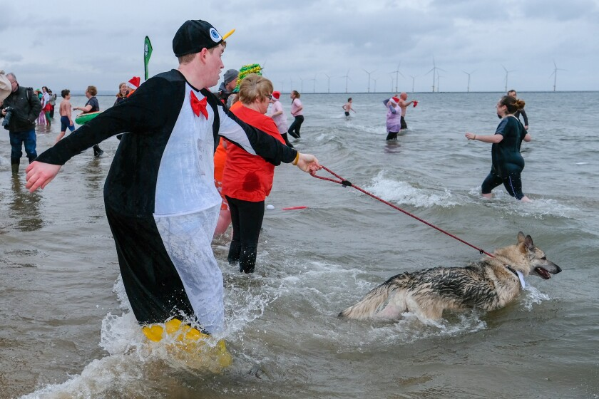Swimmers brave chilly waters for a Boxing Day dip off Redcar, England.