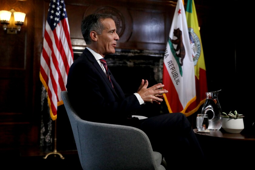 L.A. Mayor Eric Garcetti holds interviews with the media after President Joe Biden selected him as his nominee