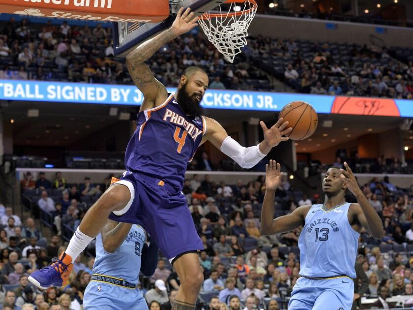 Phoenix Suns center Tyson Chandler (4) misses a basket between Memphis Grizzlies forward Jaren Jackson Jr. (13) and guard MarShon Brooks (8) in the first half of an NBA basketball game Saturday, Oct. 27, 2018, in Memphis, Tenn.