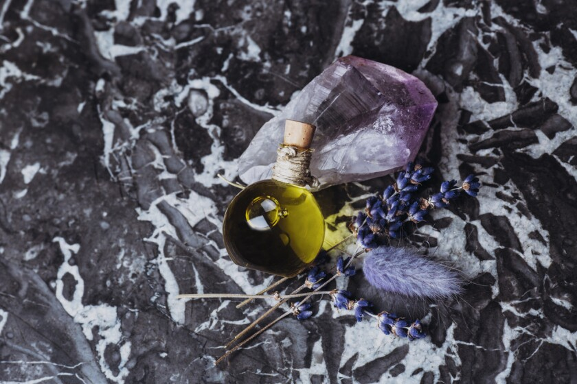 Essential oil with quartz stone, lavander and marble