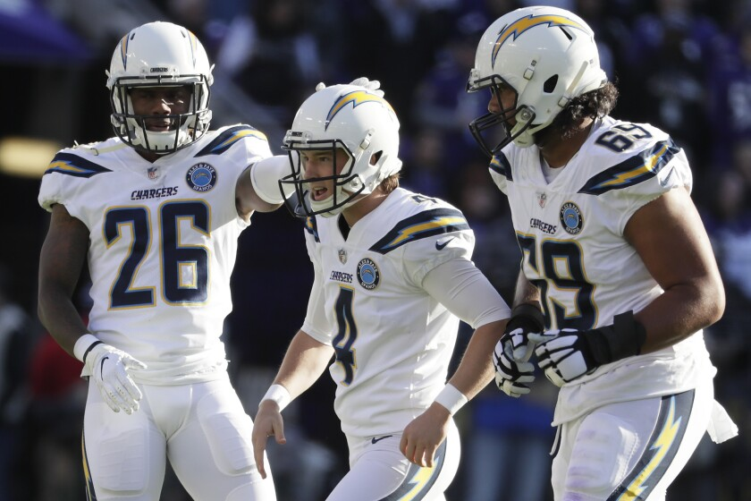 Chargers kicker Michael Badgley celebrates with teammates.