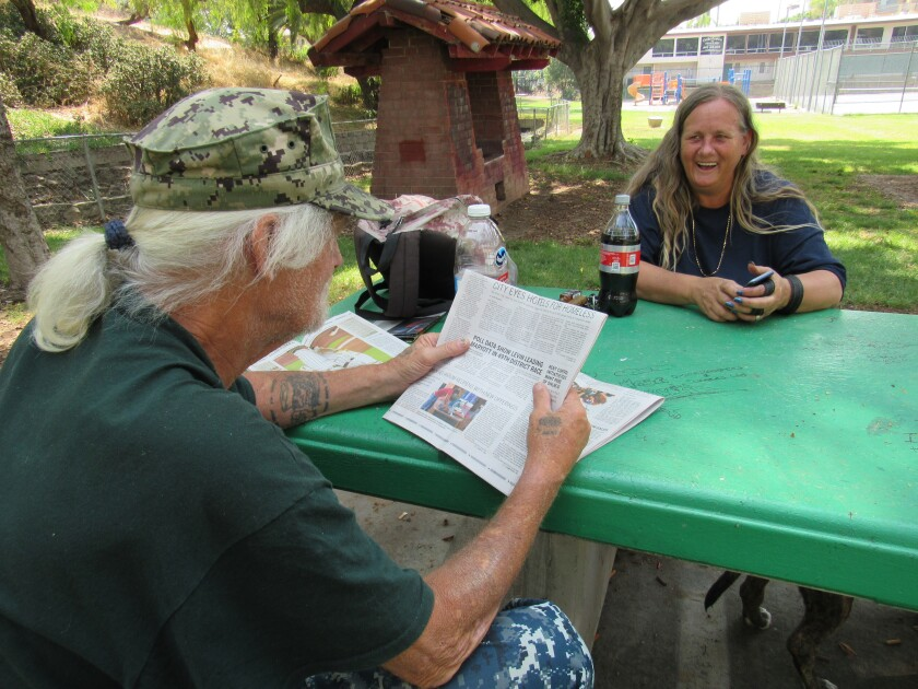 John Jacoby and Naomi Flynn take a break and discuss the news on Wednesday morning at Collier Park.