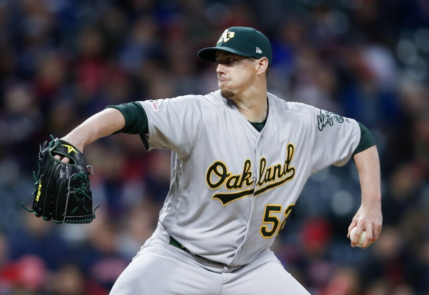 Athletics left-hander Ryan Buchter pitches against the Indians during the seventh inning of a game May 21 at Progressive Field.