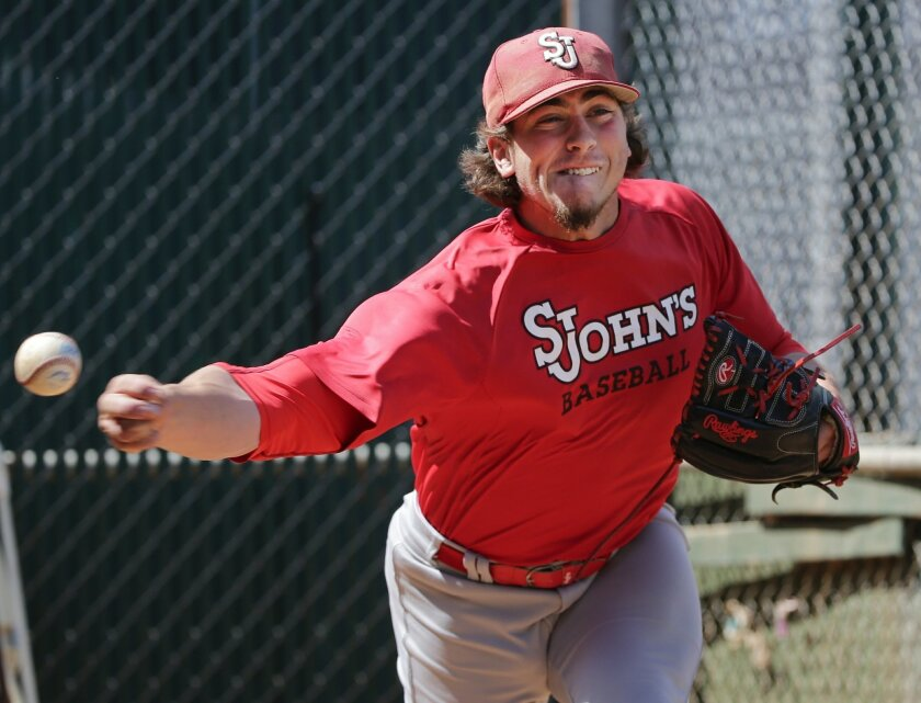 St. John's pitcher Thomas Hackimer delivers a pitch during practice Wednesday, May 11, 2016, in New York. Hackimer zips pitches past hitters with a deceptively funky sidearm-style delivery that has thoroughly dominated college baseball this season. (AP Photo/Frank Franklin II)