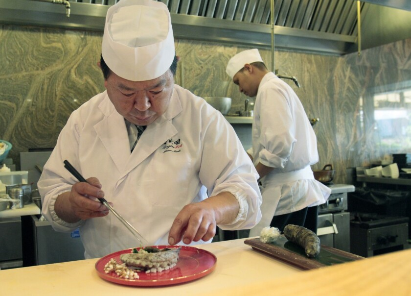 Chef Shigeru Kato, a native of Tokyo, creates one of his edomae-style sushi dishes. His sushi resembles delicate, exquisitely scented Japanese charcuterie.