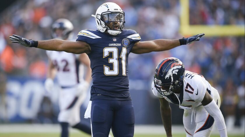 Chargers safety Adrian Phillips, left, celebrates after breaking up a pass intended for Denver wide receiver DaeSean Hamilton on Nov. 18.