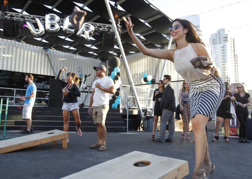 Emma Cruz, who works with Uber in Tijuana, plays a bean bag game the Quartyard in 2015.