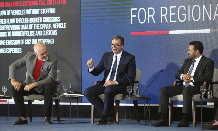Serbia's President Aleksandar Vucic, center, speaks in presence of Albania's Prime Minister Edi Rama, left, and North Macedonia's Prime Minister Zoran Zaev, right, during the economic forum for regional cooperation in Skopje, North Macedonia, Thursday, July 29, 2021. Frustrated with infinite delays in a process to join the European Union, three Balkan leaders have agreed on Thursday their countries to open borders in 2023 to secure free movement of people and goods without administrative procedures. (AP Photo/Boris Grdanoski)