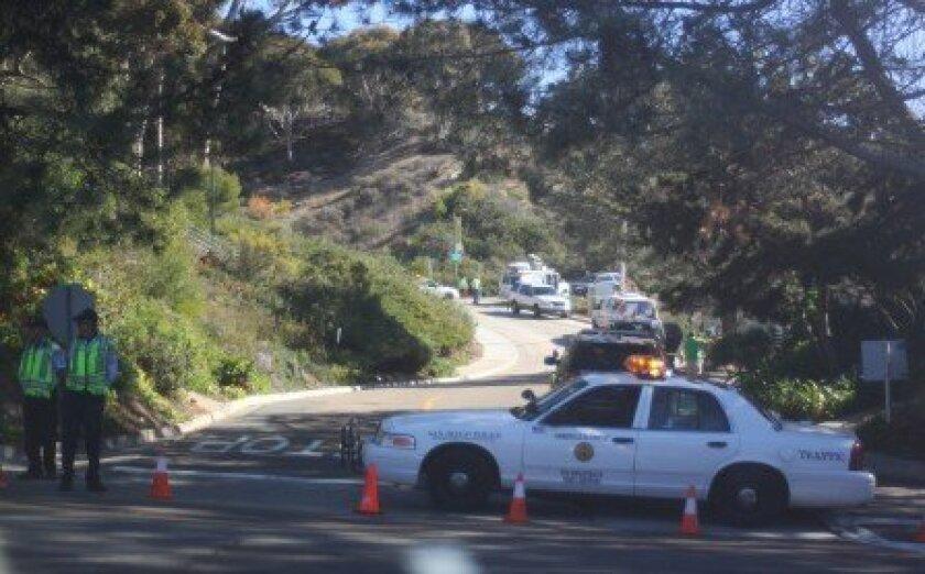 Police block an entrance to the crime scene off La Jolla Shores Drive Monday morning. Photo by Ashley Mackin