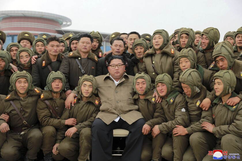 In a photo provided Monday, North Korean leader Kim Jong Un is pictured with air force sharpshooters and soldiers at an unknown location.